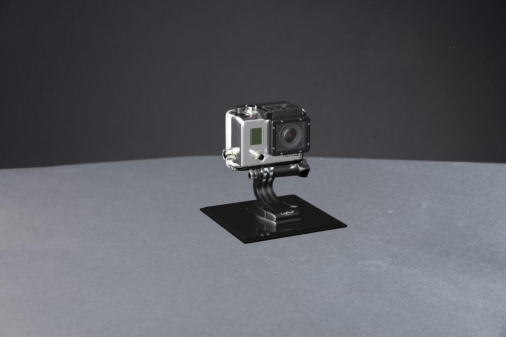 En GoPro gjord i 3D och monterad på en fotad bakgrund.